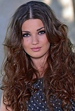 Ukrainian girl Ekaterina ,27 years old with green eyes and dark brown hair.