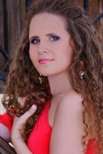 Ukrainian girl Victoria,26 years old with grey eyes and dark brown hair.