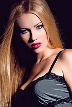 Ukrainian girl Maria,24 years old with green eyes and auburn hair.