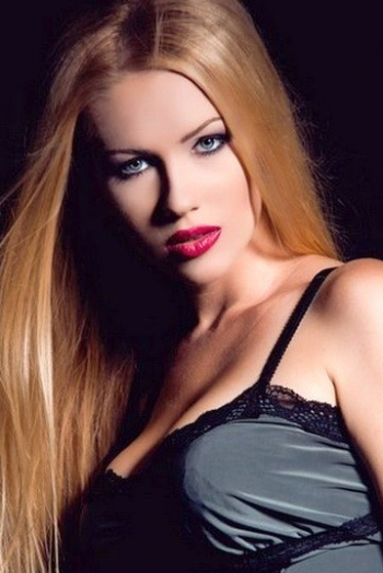 Ukrainian girl Maria,23 years old with green eyes and auburn hair.