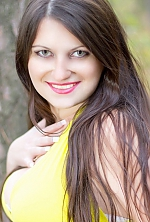 Ukrainian girl Alexandra,30 years old with green eyes and dark brown hair.