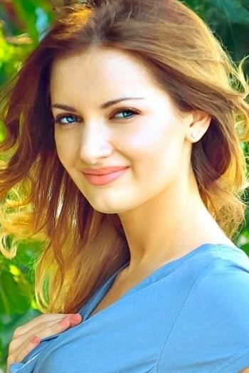 Ukrainian girl Natalia,27 years old with blue eyes and dark brown hair.
