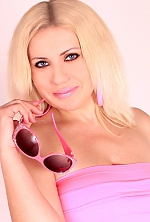 Ukrainian girl Inna,35 years old with blue eyes and blonde hair.