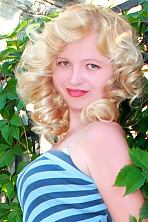 Ukrainian girl Lilia,30 years old with grey eyes and blonde hair.