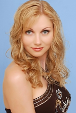 Ukrainian girl Elena,40 years old with green eyes and blonde hair.