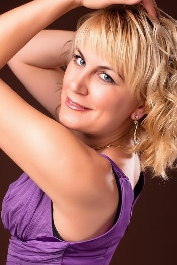 Ukrainian girl Elena,39 years old with blue eyes and blonde hair.