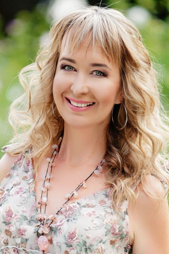 Ukrainian girl Svetlana,51 years old with green eyes and blonde hair.