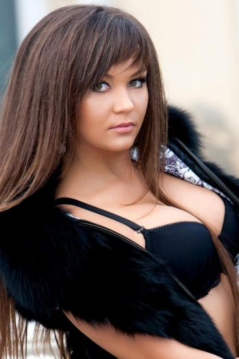 Ukrainian girl Irina,24 years old with green eyes and dark brown hair.