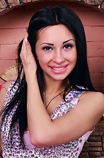 Ukrainian girl Alena,22 years old with blue eyes and black hair.