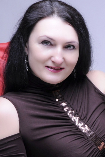 Ukrainian girl Julia,46 years old with grey eyes and black hair.