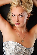 Ukrainian girl Elena,33 years old with grey eyes and blonde hair.