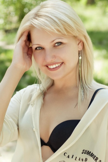 Ukrainian girl Evgeniya,28 years old with blue eyes and blonde hair.