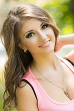 Ukrainian girl Kate,24 years old with brown eyes and light brown hair.