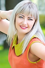 Ukrainian girl Irina,35 years old with blue eyes and blonde hair.