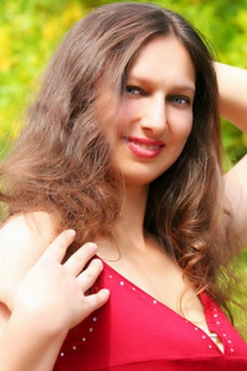 Ukrainian girl Galina,33 years old with grey eyes and light brown hair.