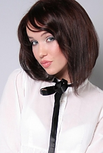 Ukrainian girl Ekaterina,27 years old with blue eyes and dark brown hair.