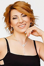 Ukrainian girl Natalia,50 years old with brown eyes and blonde hair.
