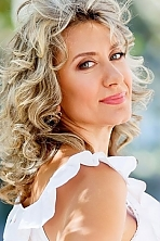 Ukrainian girl Tamara,55 years old with blue eyes and dark brown hair.