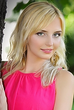 Ukrainian girl Alina,25 years old with grey eyes and blonde hair.