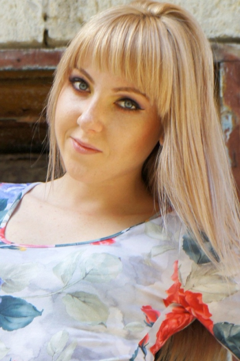Ukrainian girl Irina,27 years old with blue eyes and blonde hair.