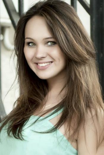 Ukrainian girl Valeriya,24 years old with green eyes and dark brown hair.