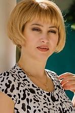 Ukrainian girl Larisa,48 years old with grey eyes and blonde hair.