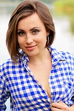 Ukrainian girl Olga,28 years old with green eyes and dark brown hair.