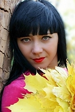 Ukrainian girl Elena,35 years old with blue eyes and black hair.