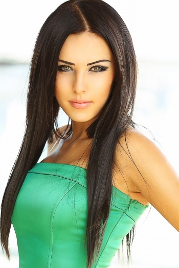 Ukrainian girl Tatiana,26 years old with green eyes and dark brown hair.