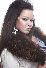 Ukrainian girl Ekaterina,31 years old with hazel eyes and dark brown hair.