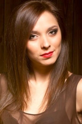 Ukrainian girl Daria,25 years old with hazel eyes and dark brown hair.