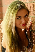 Ukrainian girl Anna,25 years old with grey eyes and blonde hair.