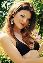 Ukrainian girl Victoria,35 years old with grey eyes and dark brown hair.