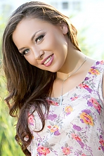 Ukrainian girl Ekaterina,30 years old with green eyes and black hair.