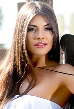 Ukrainian girl Yulia,24 years old with brown eyes and dark brown hair.