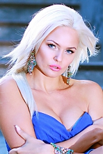 Ukrainian girl Svetlana,36 years old with grey eyes and blonde hair.