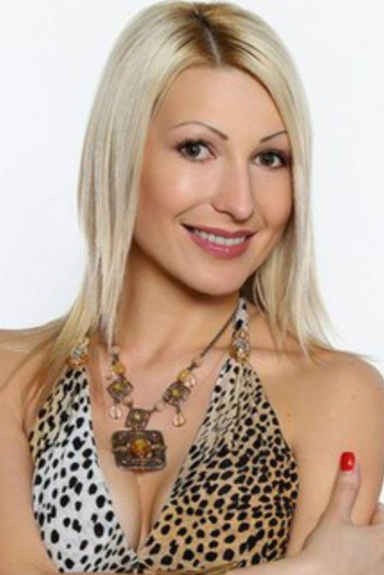 Ukrainian girl Julia,32 years old with green eyes and blonde hair.