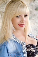 Ukrainian girl Anna,35 years old with grey eyes and blonde hair.