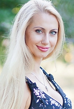 Ukrainian girl Yana,31 years old with grey eyes and blonde hair.