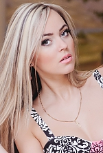 Ukrainian girl Alexandra,28 years old with green eyes and blonde hair.