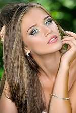 Ukrainian girl Polina,21 years old with grey eyes and light brown hair.