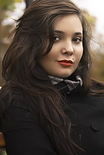 Ukrainian girl Alina,26 years old with brown eyes and black hair.