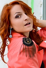 Ukrainian girl Anna,23 years old with brown eyes and red hair.