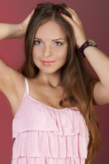 Ukrainian girl Sofia,26 years old with brown eyes and light brown hair.