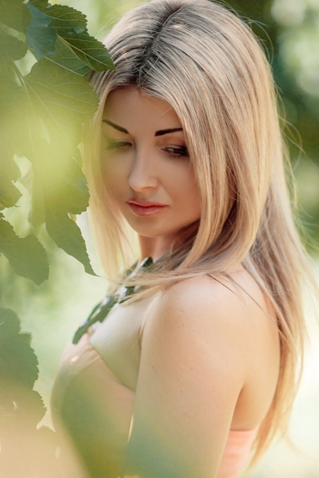Ukrainian girl Natalia,37 years old with green eyes and blonde hair.