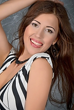 Ukrainian girl Anna,28 years old with brown eyes and dark brown hair.