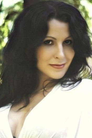 Ukrainian girl Ekaterina,34 years old with green eyes and black hair.