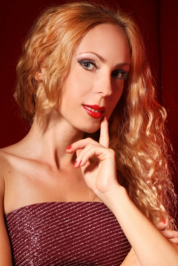 Ukrainian girl Yulia,31 years old with green eyes and blonde hair.
