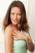 Ukrainian girl Marina,38 years old with blue eyes and black hair.