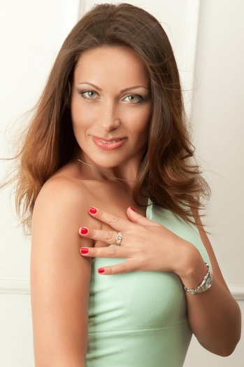 Ukrainian girl Marina,38 years old with blue eyes and black hair.